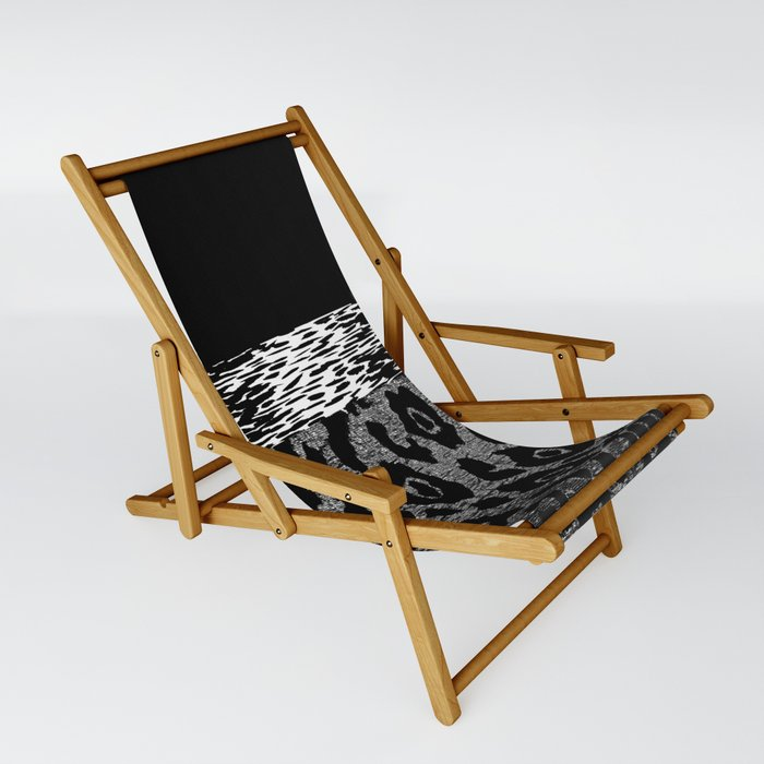 ANIMAL PRINT CHEETAH LEOPARD BLACK WHITE AND SILVERY GRAY Sling Chair By Saundramyles