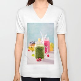 Close-up of green fresh smoothie with fruits, berries, oats and seeds, selective focus Unisex V-Neck