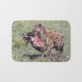 A spotted hyena with a head of wildebeest, Serengeti, Tanzania Bath Mat