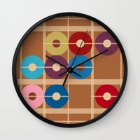 alchemy Wall Clocks featuring Cooper Alchemy by Ramon J Butler-Martinez
