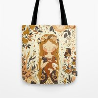 pink Tote Bags featuring The Queen of Pentacles by Teagan White