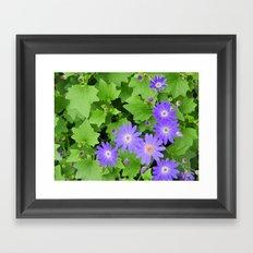 Purple flowers on leafy greens Framed Art Print
