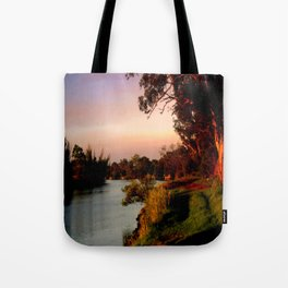 Reflecting sunset on the river Bank Tote Bag