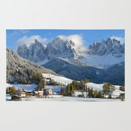 Dolomites village in the snow in winter Rug