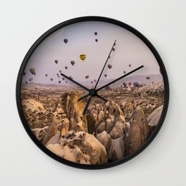 Flight above the mountains Wall Clock
