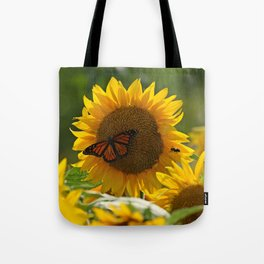 The butterfly the bee and the sunflower Tote Bag