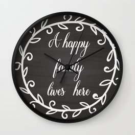 A happy family lives here Wall Clock