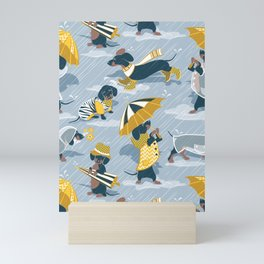 Ready For a Rainy Walk // pastel blue background dachshunds dogs with yellow and transparent rain co Mini Art Print