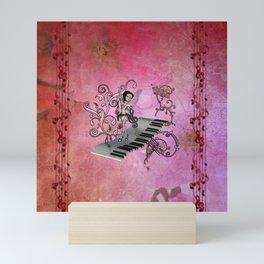 Cute fairy dancing on a piano Mini Art Print
