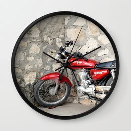 Motorbike red parked by the cement wall Wall Clock