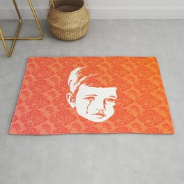 Faces - crying gypsy boy on a red and orange floral background Rug