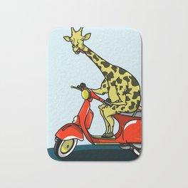 Giraffe riding a moped Bath Mat