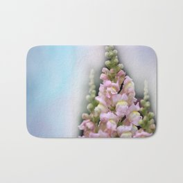 snapdragons and sky Bath Mat