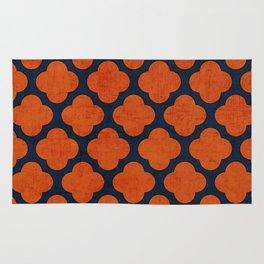 navy and orange clover Rug