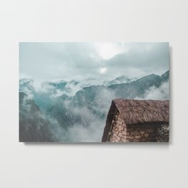Ancient stone Inca house with straw roof and blue misty Andes mountains at Machu Picchu, Peru Metal Print