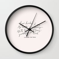 winnie the pooh Wall Clocks featuring LUCKY - WINNIE THE POOH QUOTE by MINNA MAY DESIGN