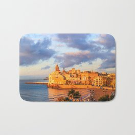 View of Sitges, Spain basking in the early morning sunshine Bath Mat