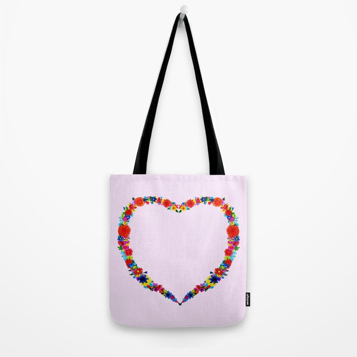 heart made of flowers on a pink background Tote Bag