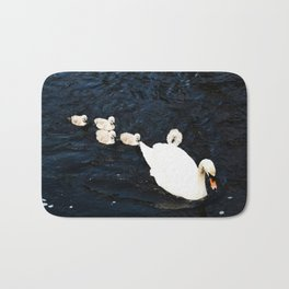Cygnets on water Bath Mat