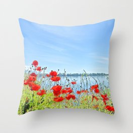 Red poppies in the lakeshore Throw Pillow