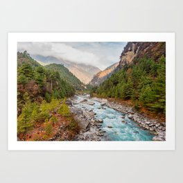 River flows through a Nepalese valley surrounded by a green pine forest on a cloudy day. Art Print