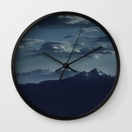 Lonely peak of the mountains Wall Clock