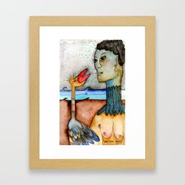 Woman with bird in the ocean at nigth Framed Art Print