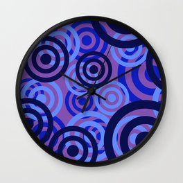 Blue Rings violet background Wall Clock