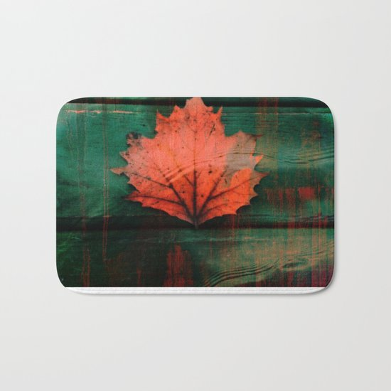 Rusty red dried fall leaf on wooden hunter green beams Bath Mat