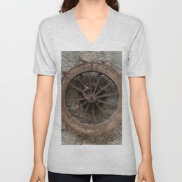 Wooden wheel hanging on a stone wall Unisex V-Neck