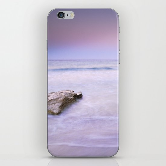 Pink sunset at the volcanic beach iPhone & iPod Skin