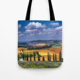 Cypress trees and meadow with typical tuscan house Tote Bag