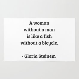 Gloria Steinem Feminist Quotes - A woman without a man is like a fish without a bicycle Rug
