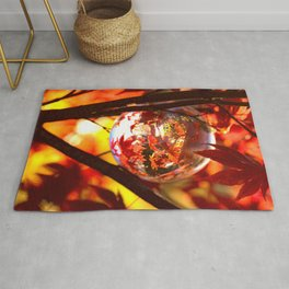 Red autumn foliage in the world of a globe Rug