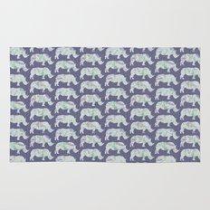 speckled rhinos Rug