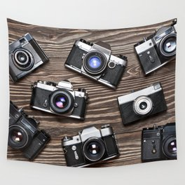 Collection of retro photo cameras on  wood Wall Tapestry