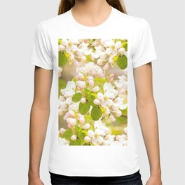 Apple tree branches with lovely flowers and buds on a pastel green background T-shirt