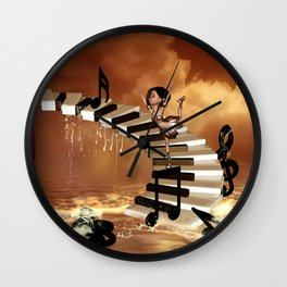 Cute little girl dancing on a piano Wall Clock