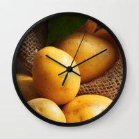 potato Wall Clocks featuring potato sack by Tanja Riedel