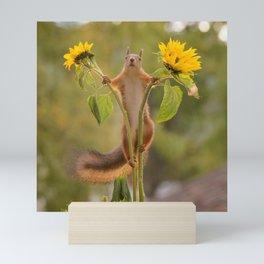 squirrel between sunflowers Mini Art Print