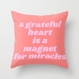 magnet for miracles Throw Pillow