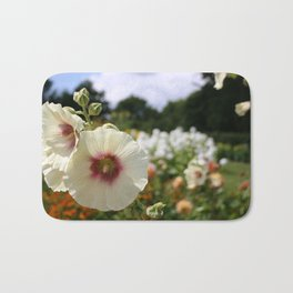 White and Red Hollyhock flower Bath Mat