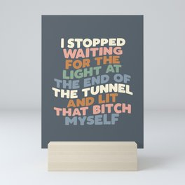 I STOPPED WAITING FOR THE LIGHT AT THE END OF THE TUNNEL AND LIT THAT BITCH MYSELF blue peach green Mini Art Print