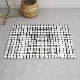 Shibori black dash lines Rug