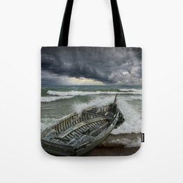 Shipwrecked Wooden Boat amidst Crashing Waves Tote Bag
