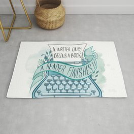 A WRITER ONLY BEGINS A BOOK Rug