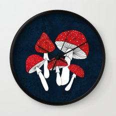 Red mushrooms field on navy blue Wall Clock