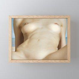 Nude woman lying on the beach Framed Mini Art Print