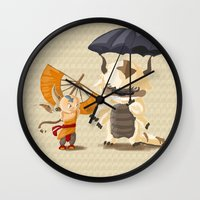 aang Wall Clocks featuring Cross over Ghibli Appa  by Minette Wasserman