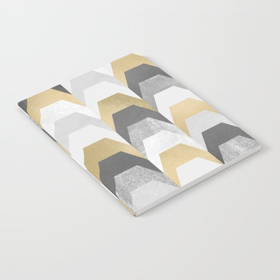 Stacks of Gold and Grey Notebook